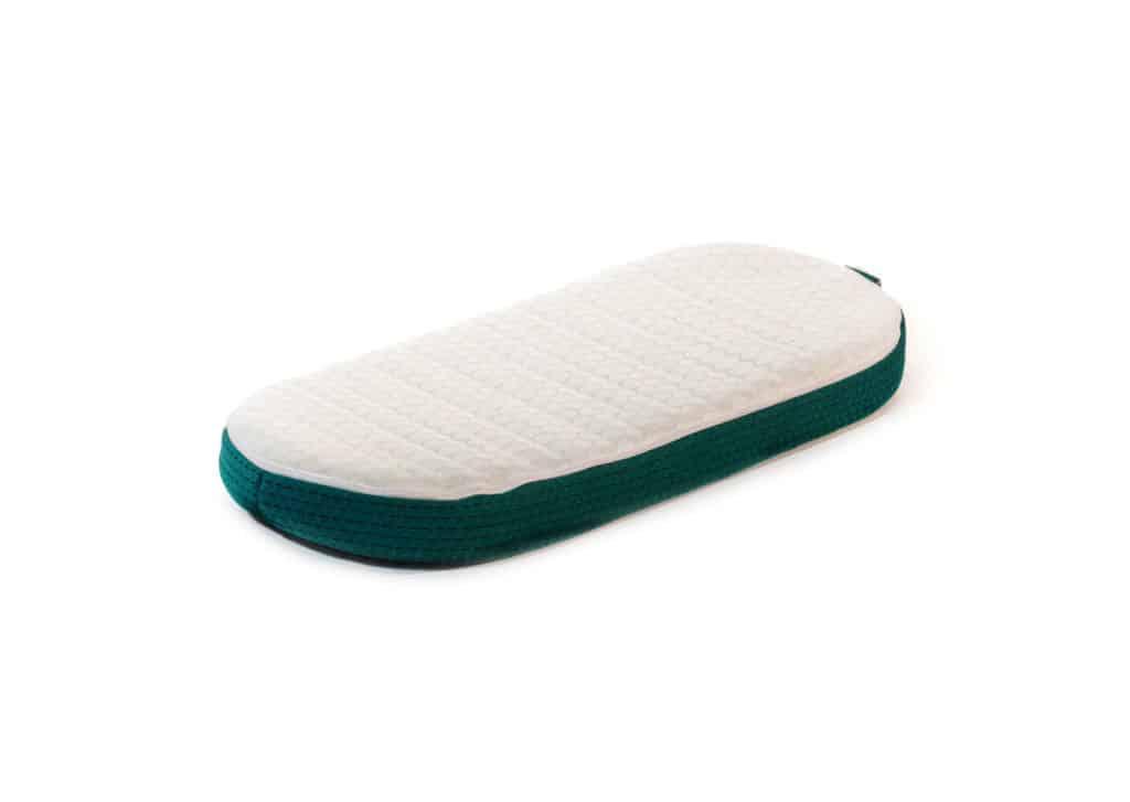 colchón de minicuna ovalado modelo volana de lémur baby
